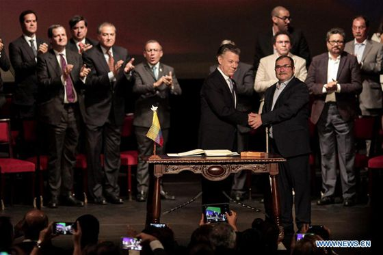 Colombia And FARC Rebels Sign Revised Peace Deal class=