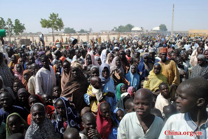 This file photo taken on February 2, 2016 shows Internally Displaced Persons (IDP) mostly women and children waiting to be served with food at Dikwa Camp, in Borno State in north-eastern Nigeria. [Photo/China.org.cn]