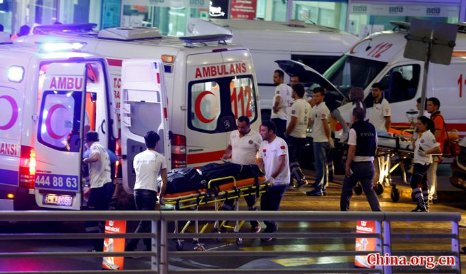 Ambulances arrive at Turkey's largest airport, Istanbul Ataturk, Turkey, following a blast on June 28, 2016. [Photo/China.org.cn]