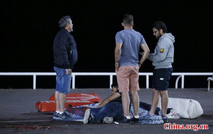 An injured individual is seen on the ground after 85 people were killed in Nice, France, when a truck ran into a crowd celebrating the Bastille Day national holiday July 14, 2016. [Photo/China.org.cn]