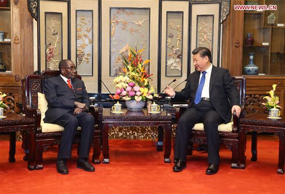 Chinese President Xi Jinping (R) meets with his Zimbabwean counterpart, Robert Gabriel Mugabe, in Beijing, capital of China, Jan. 9, 2017. [Photo/Xinhua]