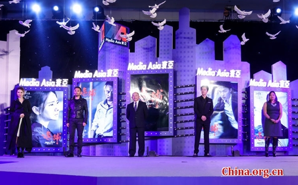 Cast members and director John Woo appear on stage with new release posters at a press conference to promote the new film 'Manhunt' directed by John Woo in Beijing, Jan. 15, 2017. [Photo/China.org.cn]