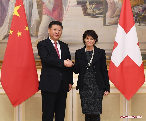 Chinese President Xi Jinping (L) shakes hands with his Swiss counterpart Doris Leuthard in Bern, Switzerland, Jan. 16, 2017. [Photo/Xinhua]