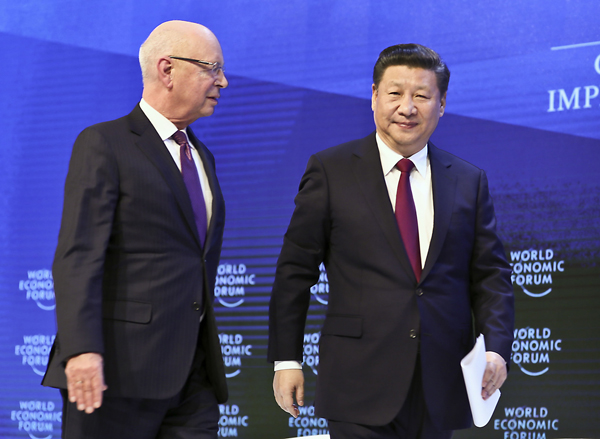 Klaus Schwab, Founder and Executive Chairman of the WEF (L) walks out with Chinese President Xi Jinping after a session during the World Economic Forum (WEF) annual meeting in Davos, Switzerland January 17, 2017. [Photo/Xinhua]
