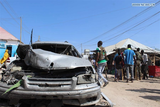 Photo taken on Feb. 19, 2017 shows the wreckage of a car at an explosion site in Mogadishu, Somalia. [Photo/Xinhua]