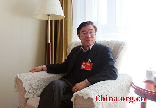Huang Youyi, a member of the Chinese People's Political Consultative Conference and executive vice president of the Translators Association of China, talks to a China.org.cn reporter in Beijing, March 6, 2017. [Photo/China.org.cn]