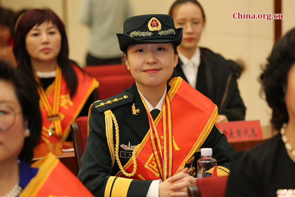 Captain Li Xiaomi receives the National March 8 Red-Banner Collective award on March 8, International Women's Day. [Photo provided to China.org.cn]