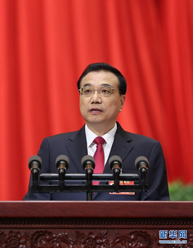 3月5日,李克强总理代表国务院在十二届全国人大五次会议上作《政府工作报告》。 [新华社]