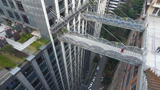 High footbridges cross tall buildings