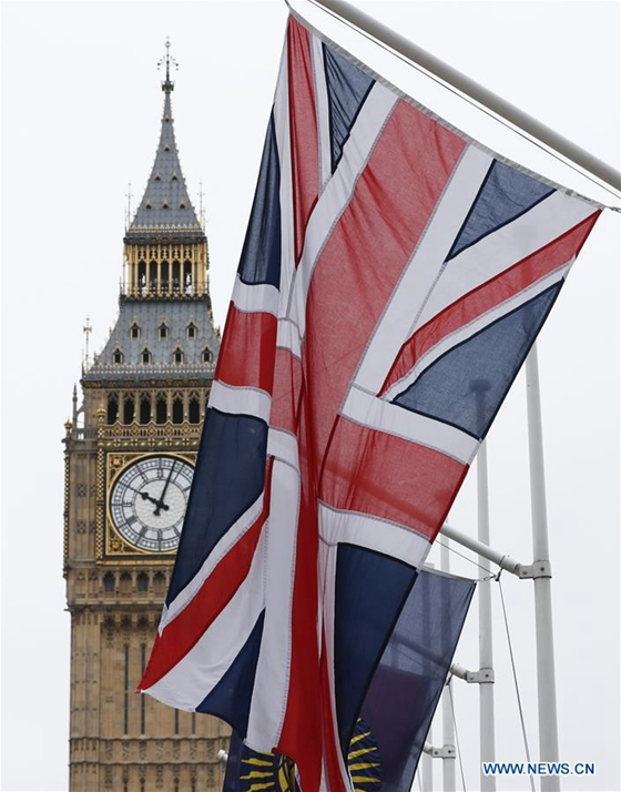 Photo taken on March 14, 2017 shows the Big Ben and the UK flag in central London, Britain. The British upper house of the Parliament passed the Brexit Bill Monday night, clearing the last hurdle for the government to trigger Brexit. [Photo/Xinhua]