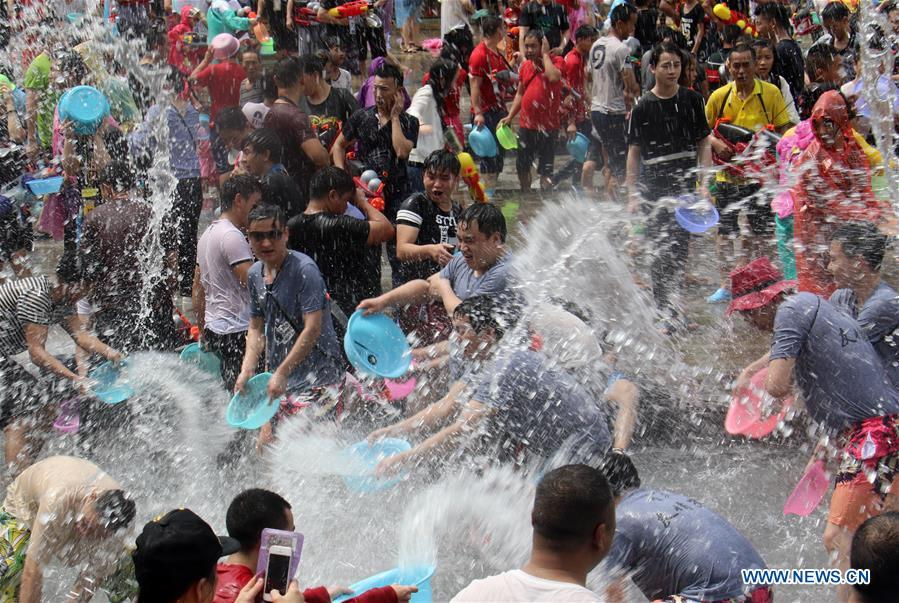 Water-sprinkling festival marked in SW China