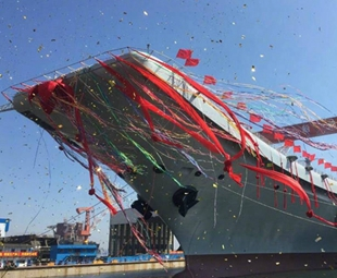 China's first home-built aircraft carrier hits the water