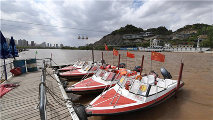 Tourists take sightseeing speedboat on Yellow River in China's Lanzhou