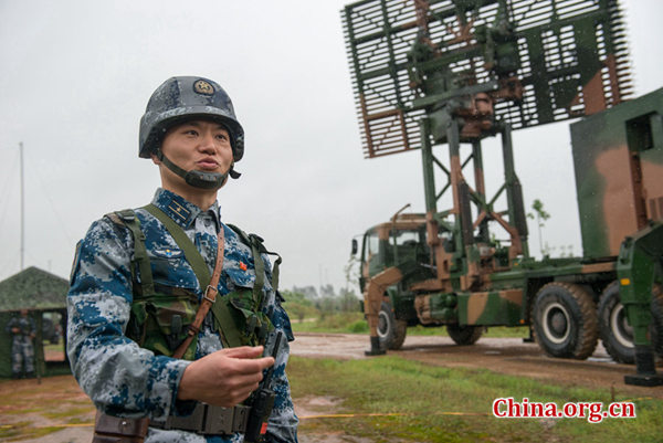 Guo Tao, commander a mobile radar force of the Southern Theater Command of the PLA (People's Liberation Army) speaks about the battalion's resolution to guard the country's airspace during a training at an undisclosed location. [Photo by Chen Boyuan / China.org.cn]