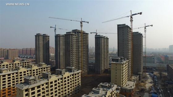 Photo taken on March 18, 2016 shows residential buildings under construction in Changchun, capital of northeast China's Jilin Province. [Photo/Xinhua]