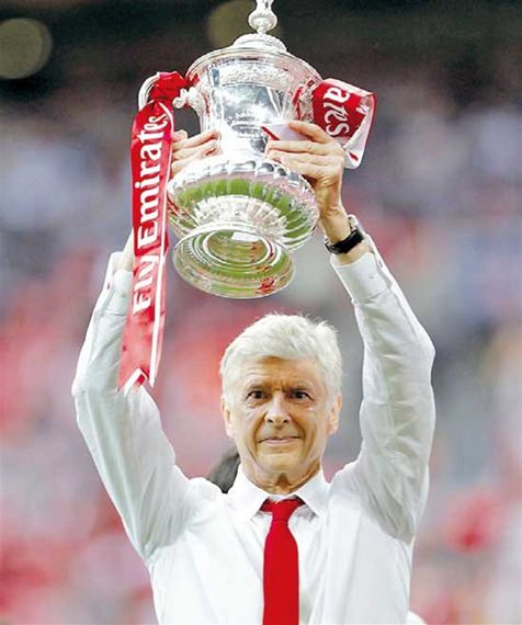 Arsenal 'signs Wenger for two more years'