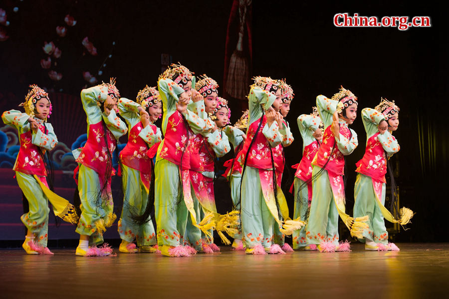 Children perform Peking Opera in Beijing on May 31, as part of an event celebrating the upcoming International Children's Day. The event is held by Beijing-based not-for-profit organization China Soong Ching Ling Foundation. [Photo by Chen Boyuan/China.org.cn]