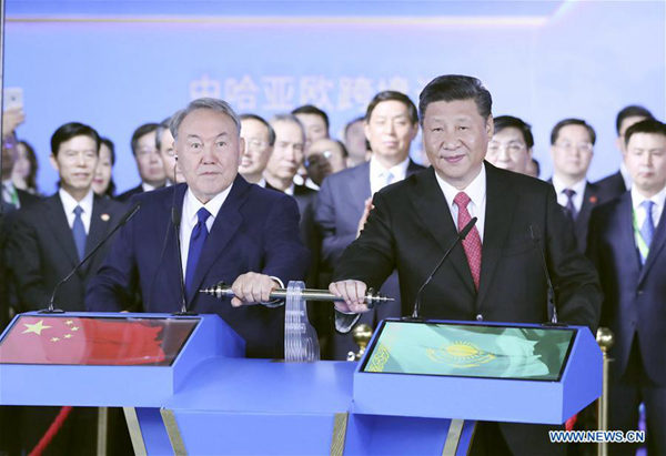 Chinese President Xi Jinping (R front) and his Kazakh counterpart Nursultan Nazarbayev (L front) inspect via videolink two key hubs of the cross-border transportation at the Chinese national pavilion of the Expo 2017 in Astana, Kazakhstan, June 8, 2017. (Xinhua/Ding Lin)