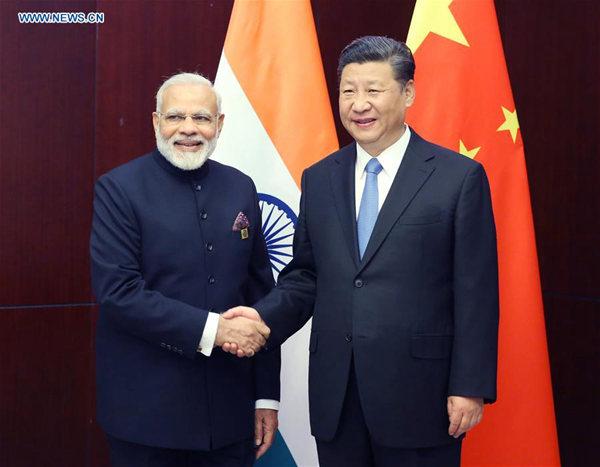 Chinese President Xi Jinping (R) meets with Indian Prime Minister Narendra Modi in Astana, Kazakhstan, June 9, 2017. (Xinhua/Yao Dawei)