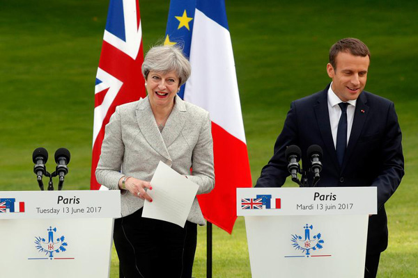 UK PM Thersa May and DUP have largely agreed support deal