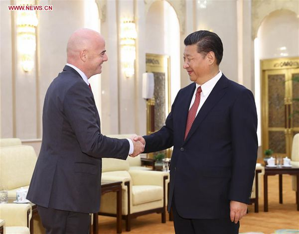 Chinese President Xi Jinping (R) meets with FIFA president Gianni Infantino in Beijing, capital of China, June 14, 2017. [Photo/Xinhua]
