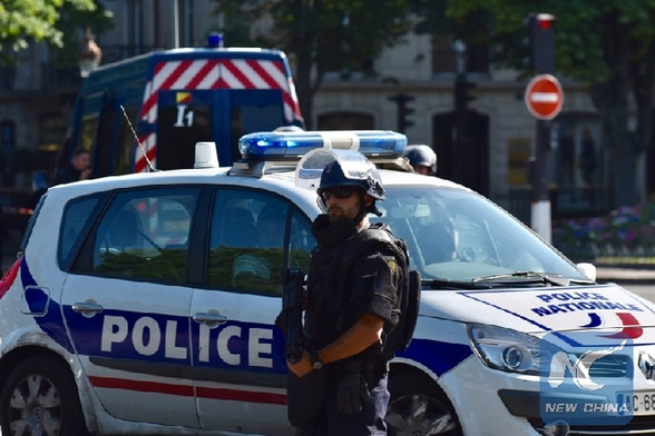 Police officers patrol near the Champs-Elysees avenue on June 19, 2017 in Paris, France. A car rammed into a police van Monday on the Champs-Elysees avenue inParis before bursting into flames, French Interior Minister Gerard Collomb said. [Photo/Xinhua]