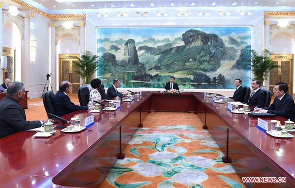 Chinese President Xi Jinping (4th R) meets with the heads of delegations from Brazil, Russia, India and South Africa who are in Beijing to attend the BRICS foreign ministers' meeting in Beijing, capital of China, June 19, 2017. [Photo/Xinhua]