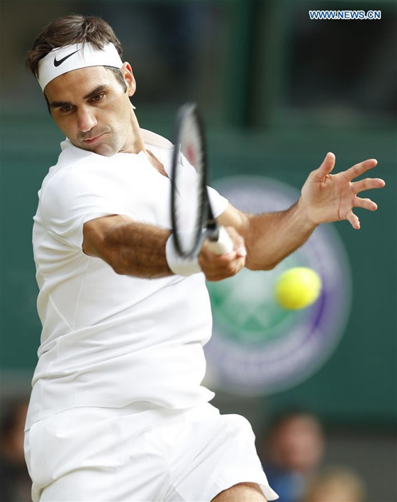 Roger Federer of Switzerland returns the ball during the men's singles semifinal match with Tomas Berdych of the Czech Republic at the Championship Wimbledon 2017 in London, Britain on July 14, 2017. [PhotoXinhua]