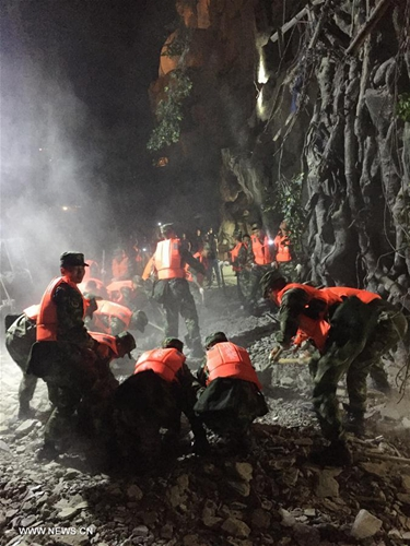 Rescuers work at a quake-hit tourist site in Zhangzha town, Jiuzhaigou County, southwest China's Sichuan Province, Aug. 9, 2017. [Photo/Xinhua]