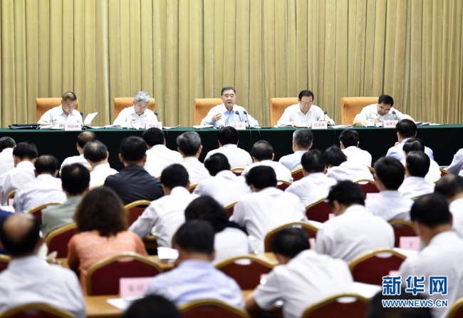 Chinese Vice Premier Wang Yang (C), who attended the meeting Tuesday, said east-west collaboration needs to be strengthened in accordance with the poverty reduction target.[Photo: Xinhua]