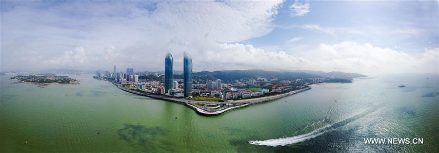 Aerial panoramic photo combined on Aug. 24, 2017 shows a part of Xiamen, a coastal city in southeast China's Fujian Province. The BRICS summit and the Dialogue of Emerging Markets and Developing Countries are to be held here from Sept. 3 to 5. (Xinhua/Wang Jianhua)