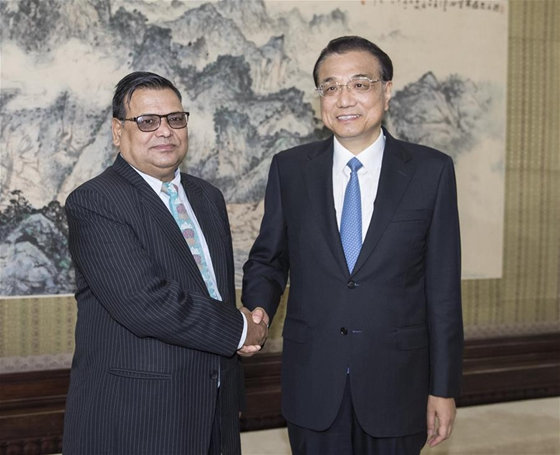 Chinese Premier Li Keqiang (R) meets with Nepalese Deputy Prime Minister and Foreign Minister Krishna Bahadur Mahara in Beijing, capital of China, Sept. 7, 2017. [Photo/Xinhua]