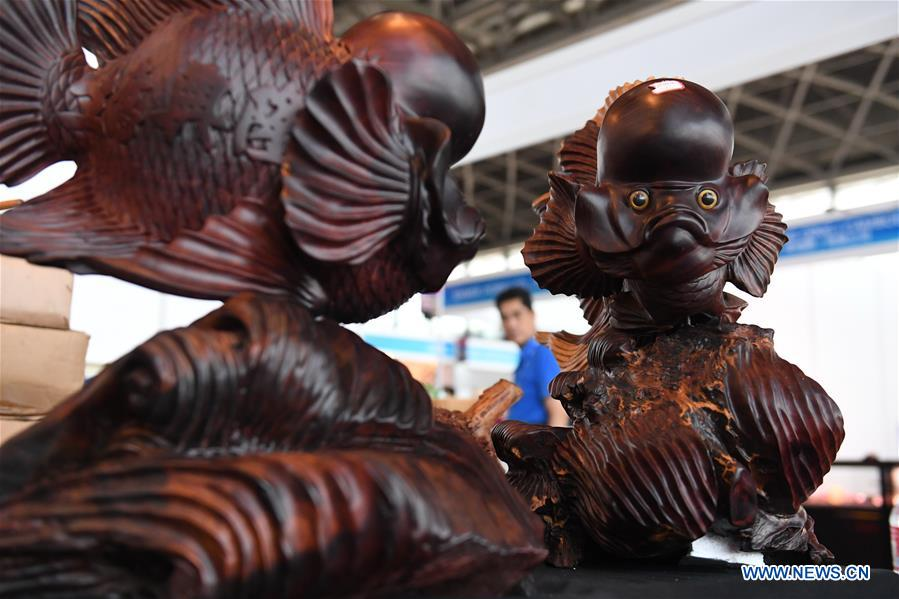 Photo taken on Sept. 13, 2017 shows wooden fish at the Cambodian pavilion during the 14th China-ASEAN Expo in Nanning, capital of south China's Guangxi Zhuang Autonomous Region. The 14th China-ASEAN Expo opened here Tuesday, highlighting trade and investment among China, ASEAN and other countries along the Belt and Road.(Xinhua/Zhou Hua)