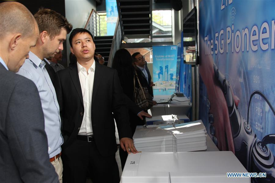 People visit ZTE's 5G radio network access equipment on ZTE Innovation Day in Budapest, Hungary on Sept. 12, 2017. Chinese telecommunication firm ZTE Corporation presented the details of its revolutionary 5G developments on Tuesday here on ZTE Innovation Day. (Xinhua/Yang Yongqian)