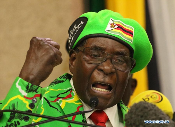 Mugabe fires one minister, demotes several others in cabinet reshuffle