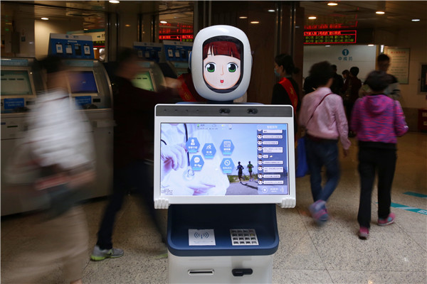 The first AI healthcare robot is introduced at a hospital in Hangzhou, Zhejiang province. [Photo by Long Wei/For China Daily]