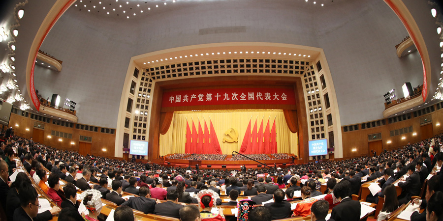 Why has China adopted the CPC-led multi-party cooperation system?