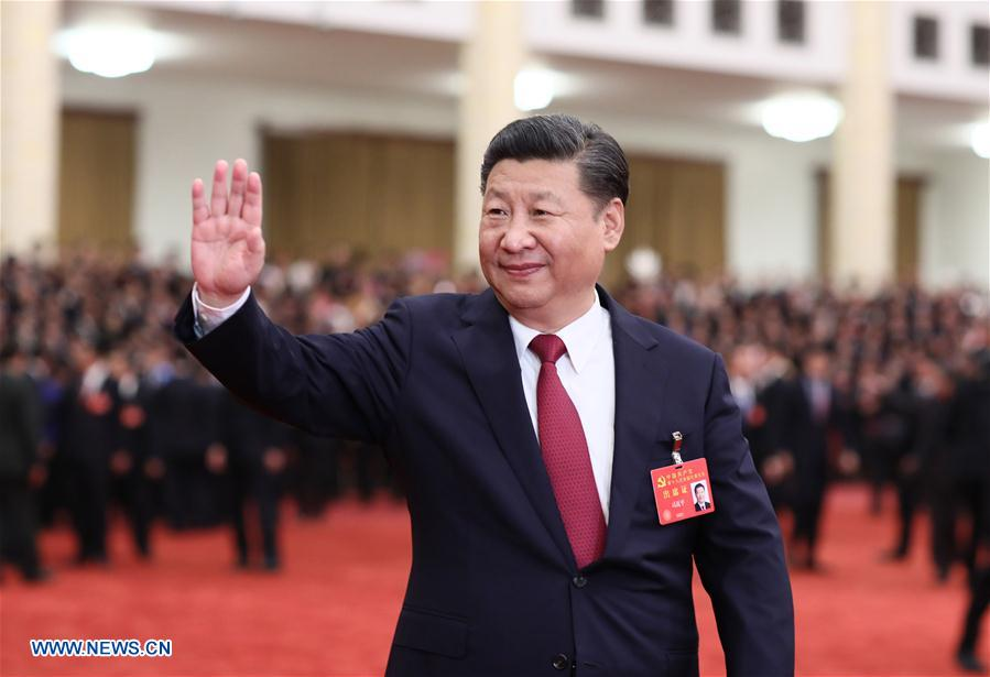 Xi Jinping, general secretary of the Communist Party of China (CPC) Central Committee, who is also Chinese president and chairman of the Central Military Commission, meets with delegates, specially invited delegates and non-voting participants of the 19th CPC National Congress at the Great Hall of the People in Beijing, capital of China, Oct. 25, 2017. (Xinhua/Lan Hongguang)