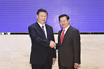 President Xi meets Lao PM on ties