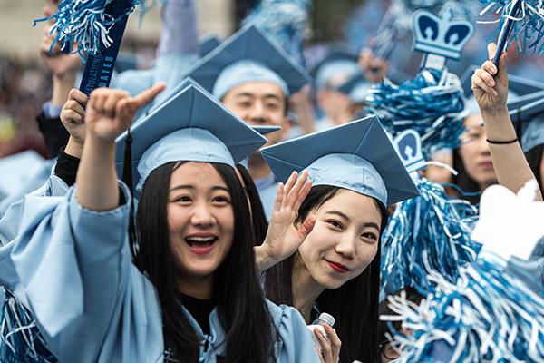 Several Chinese students cheer at Colombia University graduation ceremonies last year in New York City. [Photo/Xinhua]