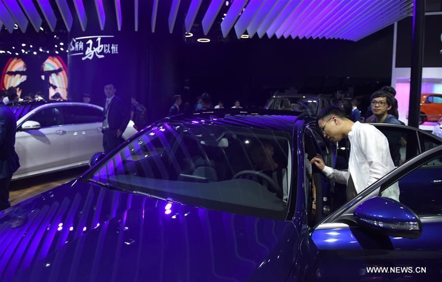 Visitors try cars at the 15th Guangzhou International Automobile Exhibition in Guangzhou, capital of south China's Guangdong Province, Nov. 17, 2017. The exhibition started on Friday and attracted many international manufacturers of cars and parts. The event will last till Nov. 26. (Xinhua/Lu Hanxin)