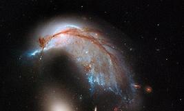 NASA公佈星系相撞震撼照片 形似企鵝護蛋