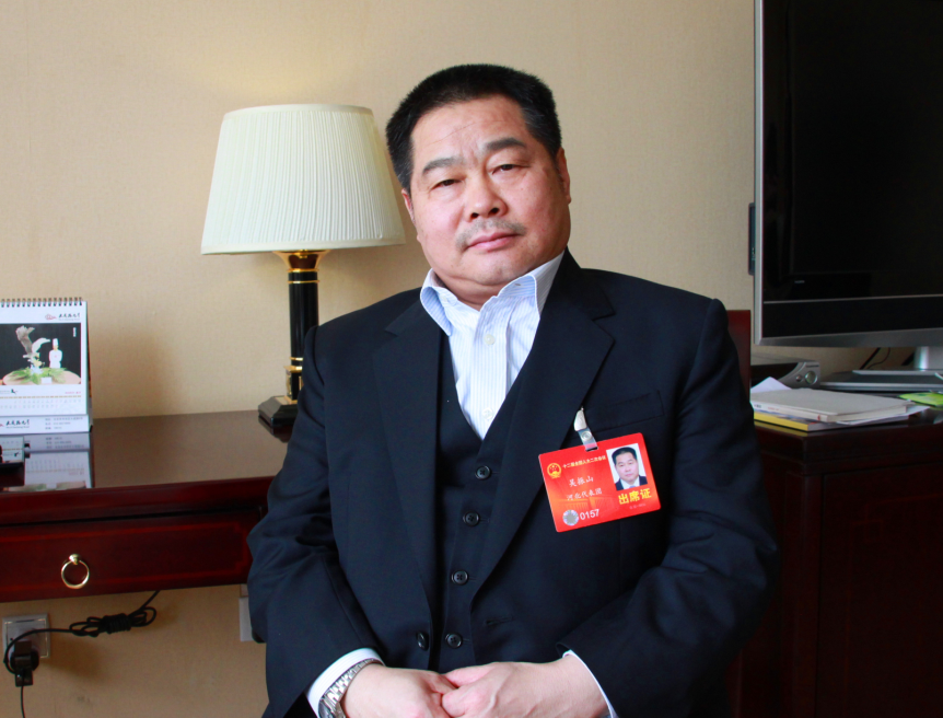 Wu Zhenshan, chairman of Tianshan Group in Hebei Province, proposed to use overall communities to solve the issue of the aging population in China.[Photo/China.org.cn]