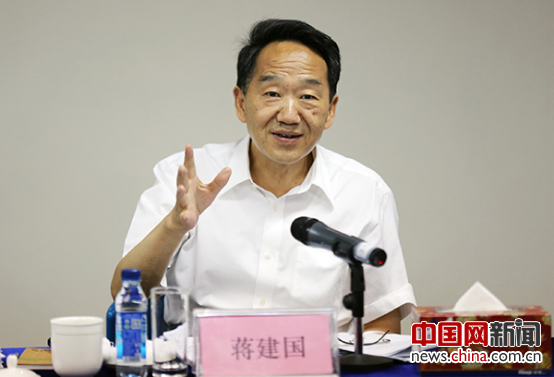 Jiang Jianguo, vice minister of the Publicity Department of the Central Committee of the Communist Party of China and minister of the State Council Information Office, addresses the seminar on a China.org.cn program in Beijing on July 18. [Photo/China.org.cn]