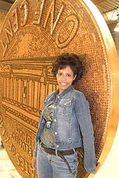Wander Martich poses in front of her gigantic penny.