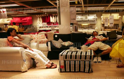 Great Some People In Shanghai Choose To Spend Their Free Times In IKEA Furniture  Stores In The Scorching Summer Day.