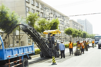 汉沽奋战300天市容环境综合整治 东风路整修一新