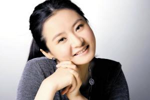 深圳美女钢琴家将弹响大运奏鸣曲