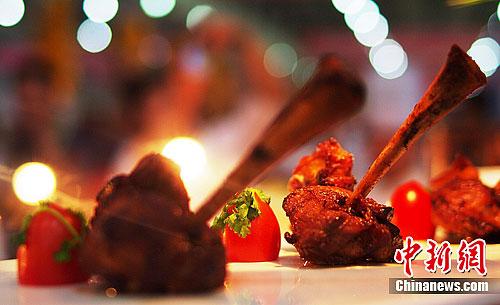 李一芳/图为各国参赛选手烹调的菜式令现场游客叹为观止。李一芳摄