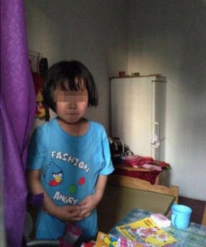组图:7岁小女孩遭继父殴打